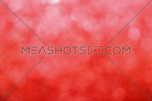 Red bokeh defocused blurred lights and sparkles abstract background