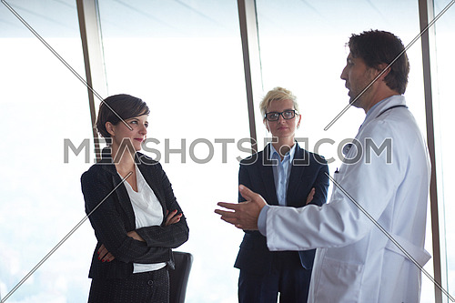 doctor with a patient family at bright modern office in hospital
