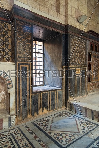 Hall at ottoman era historic house of Moustafa Gaafar Al Seleehdar located at Al Darb Al Asfar District, Cairo, Egypt with decorated wooden wall and marble floor