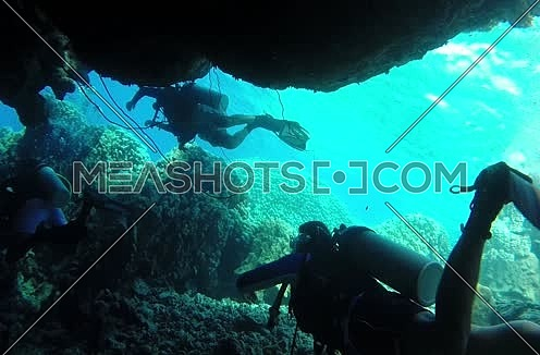 Follow shot for scuba divers under water at The Red Sea