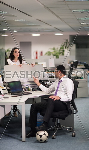 relaxed young couple at office finishing their job