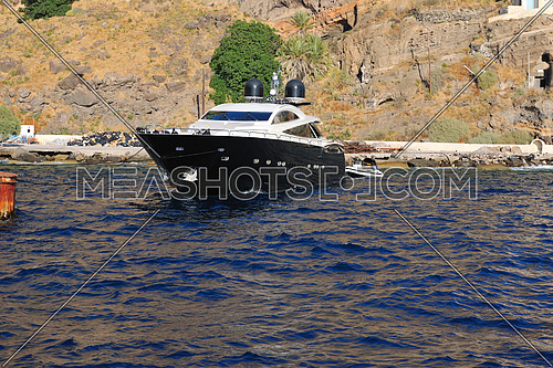 greece santorini island coast with luxury yacht