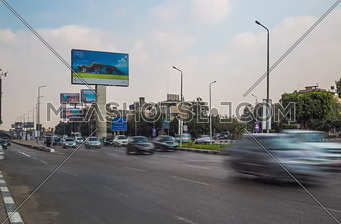 Track Right Shot for traffic at Salah Salim Street showing AL Galaa Bridge in background at Daytime