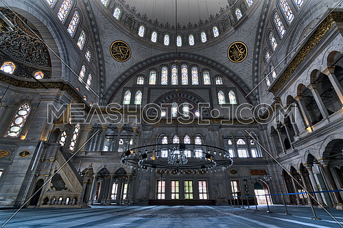 Interior of Nuruosmaniye Mosque, an Ottoman Baroque style mosque completed in 1755, with a huge dome & many colored stained glass windows located in Shemberlitash, Fatih, Istanbul, Turkey