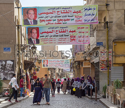 Cairo, Egypt - March 25, 2018: Banners supporting current Egyptian president Abdel-Fattah El-Sisi for a second term for the presidential elections at crowded Al Moez Street, Gamalia district
