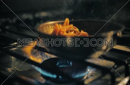 Cooking Pasta in a pan inside the kitchen