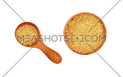 Wooden scoop spoon and bowl of brown cane sugar isolated on white background, top view