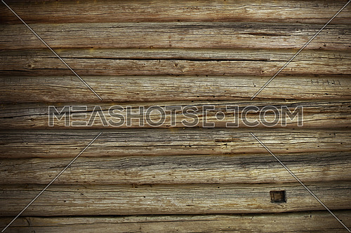 Old antique unpainted wooden vintage cracked pale logs wall of blockhouse, texture background with sharded darker border