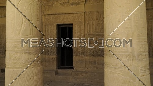 tracking shot inside Temple of Phila showing columns and writing, Aswan Egypt