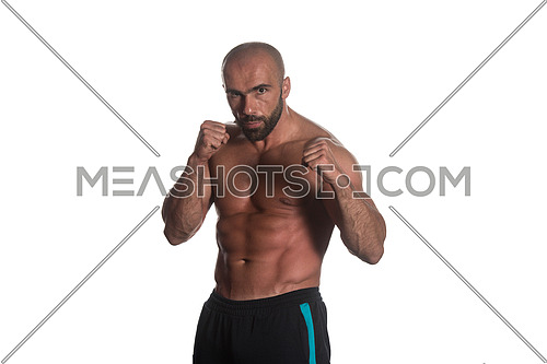 Young Muscular Sports Guy Boxing Workout Over White Background Isolated