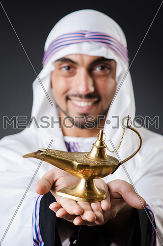 Arab with lamp isolated on the white