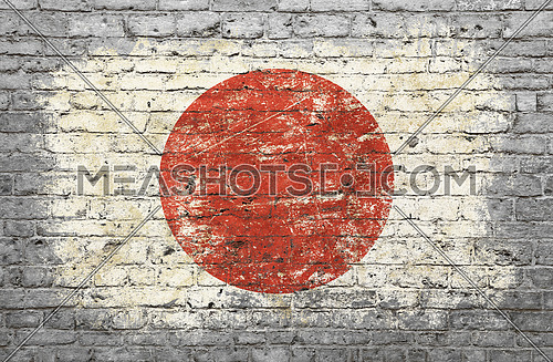 Grunge distressed flag of Japan painted on old weathered grey brick wall