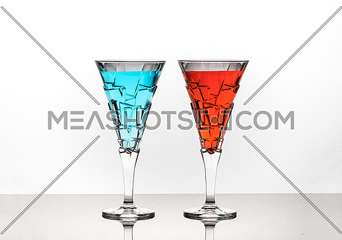 Two glasses of coloured water