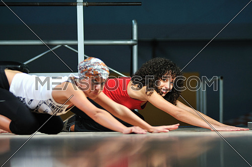 group of women working out in fitness club