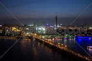Timelaps by the nile and cairo tower from sunset to night showing vibrant city