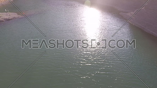 Drone Aerial Shot Fly over mountain and lake of Jebel Hafeet in Abu Dhabi at UAE at day
