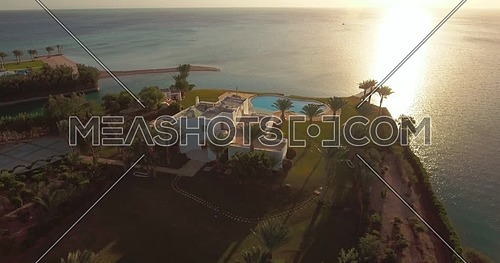 Aerial orbit shot flying abovePrivate Villa in Al Gouna at Day