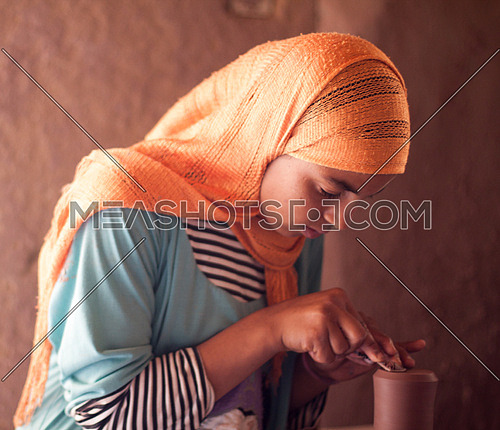 Young girl at pottery school in Tunis Village, Fayoum, Egypt