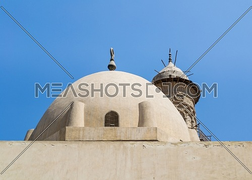 Dome at public historic mosque of Sultan Al Nassir Qalawun revealing minaret of Mamluk era El Zaher Barquq Mosque, Moez Street, Cairo, Egypt