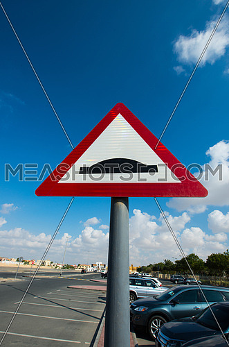 speed bump sign in a parking lot