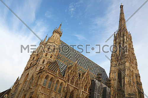 St Stephen Cathedral (Stephansdom) at Stephansplatz, the biggest cathedral and most important religious building in Vienna, Austria, over day blue sky, low angle view