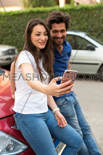 young couple taking selfie photo in the stree at korba area at day