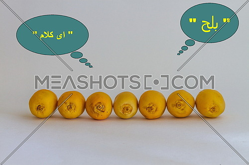 """Yellow dates arranged in a line and the word """" Dates and """" Nonsence """" written in Arabic"""