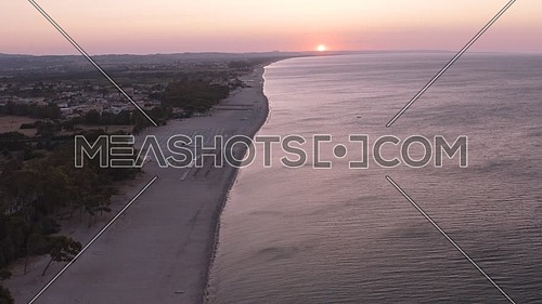 Aerial view of beautiful mediterranean sea and beach at sunrise, seascape of Calabria,  Simeri Mare, Southern Italy