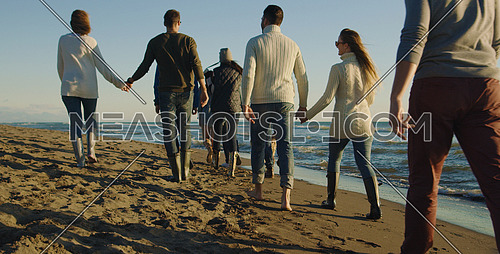 Group Of Young Friends Spending The Day On A Beach during autumn day