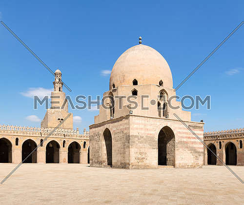 Courtyard of Ibn Tulun Mosque, Cairo, Egypt. View showing the ablution fountain and the minaret. The mosque is the largest one in Cairo, and may be the oldest mosque in the city with its original form
