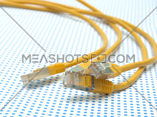 yellow ethernet cable on dotted background