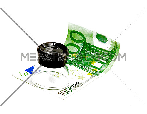 one undred euro bill and lupe on white background