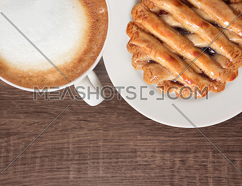 Cup of Cappuccino with Raspberry Pie on a wooden background with Ad Space