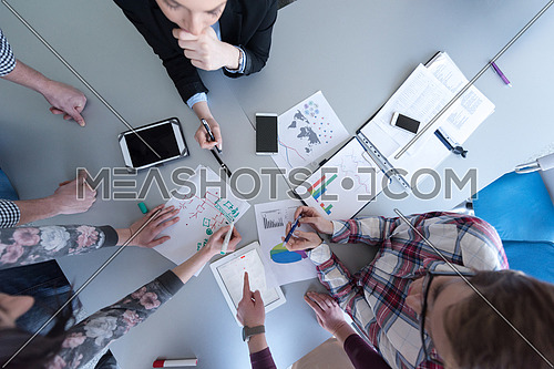 aerial top view  of business people group brainstorming on meeting and businessman presenting ideas and projects on laptop and tablet computer