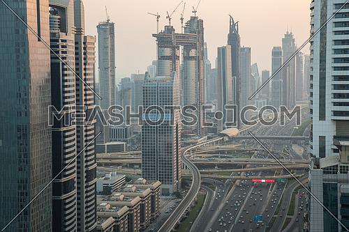 Long shot for Dubai City showing skyscrapers and traffic from day to sunset.