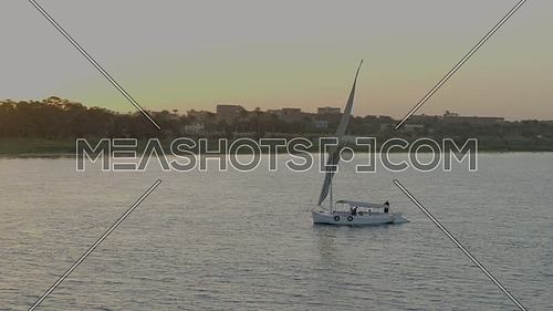 Fly over the River Nile showing a Sailboat at sunset.
