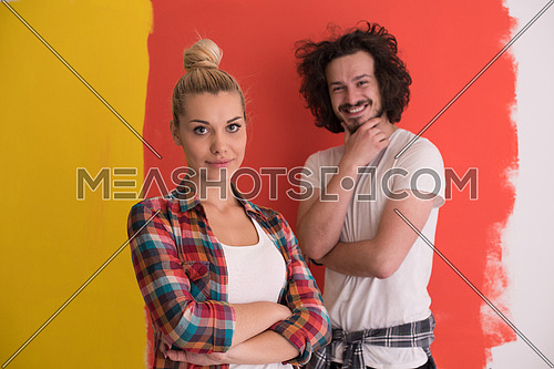Portrait of a happy young smiling couple in love  over color background