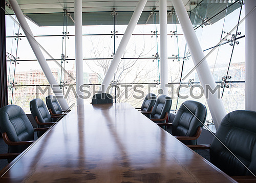 Interior of new modern corporate office meeting room with big glass windows