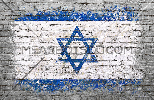 Grunge distressed flag of Israel painted on old weathered grey brick wall