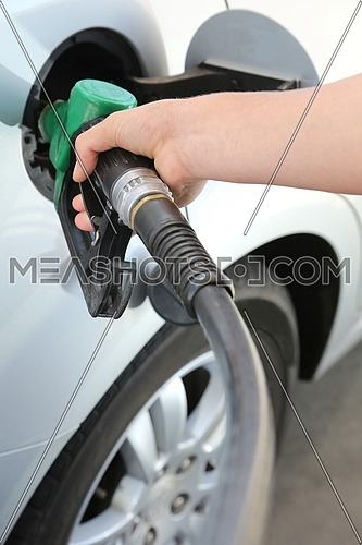 Petrol pump with nozzle in the tank