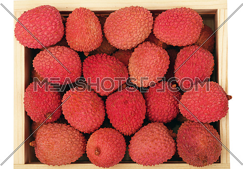 Heap of fresh picked red ripe litchee (Litchi chinensis) tropical fruits in wooden container box isolated on white background, close up, elevated top view, high angle
