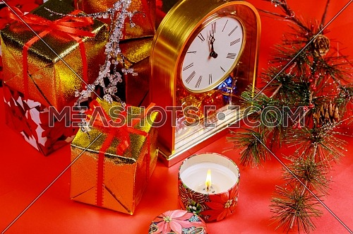 Twelve o clock. Christmas and New Year composition with red background candle light concept