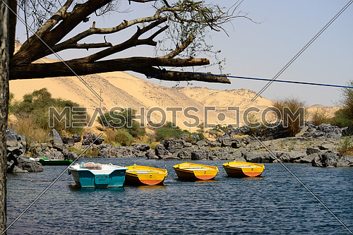 long shot for four Felluca's anchoring in the river nile at Aswan at day