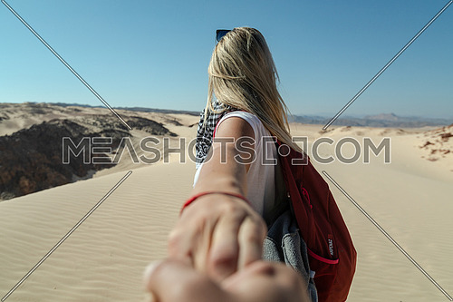 Follow me shot with blond female tourist