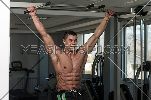 Healthy Man Exercising His Abs At The Gym