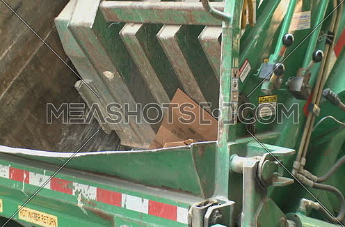 Zoom Out Shot from inside Garbage truck till revealing whole truck at New York City at day.
