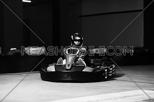 Young Woman Is Driving Go-Kart Car With Speed In A Playground Racing Track - Go Kart Is A Popular Leisure Motor Sports