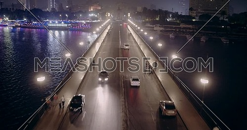 Drone shot fly in Kasr Al Nile Bridge until Saad Zagloul Statue at Opera Square in Cairo at night