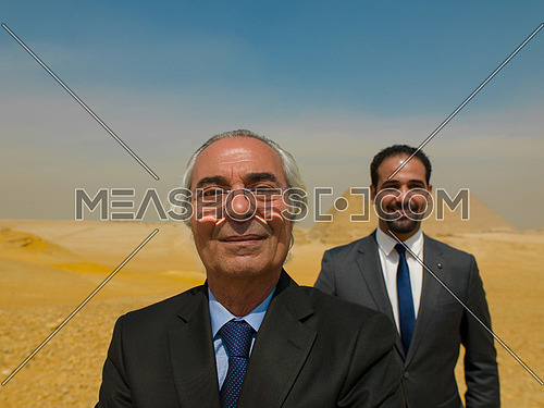 successful arab business people at Egyptian giza platou with pyramids in backgronud