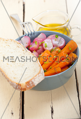 bowl of steamed root vegetable on a rustic white wood table